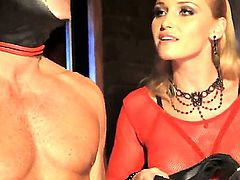 Blonde mistress Kathia Nobili is dominating over her enslaved girlfriend Sophie Lynx and over one enslaved fellow in black mask. Watch what the domina forces them to do.