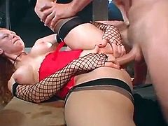 Salacious redhead Audrey Hollander is trying to please two studs in amazing MMF threesome video. She gives blowjobs to the guys and then lets them smash her cunt and butt.