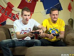 These two losers are on the couch playing video games when all of a sudden two of the female soccer players in the game burst though the screen so that they can fuck the guy. They give great blowjobs, and they love to have their pussy eaten.