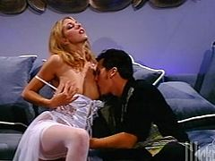 Take a look at this amazing hardcore scene where the sexy blonde Roxanne Hall is fucked by this guy while wearing stockings.