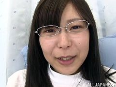 Slutty Japanese chick, An Mizuki, wearing glasses lets some man rub her pussy with a dildo. Then she gives a blowjob to the dude and they have ardent doggy style sex.