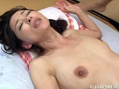 Busty Japanese milf and her man are having a good time together. They kiss and fondle each other and have awesome sex in cowgirl position.