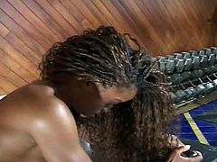 Black bitch gets horny in the gym watching a big bodybuilder at work and let him fuck her hard right on the mat.