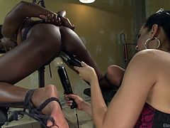 This lesbian couple shares a common passion for playing with electricity. A brunette milf wearing a tiara makes her ebony companion scream loudly. She's using a vibrator and an electric wand. The chick is strongly tied up with ropes. Enjoy this specially flavored cocktail spiced with pain and pleasure.