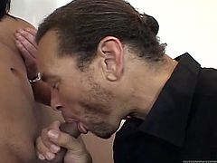 Provocative brunette shemale kneels down to give best ever blowjob to a duo of horny studs. They penetrate her throat and she looks straight in their eyes.