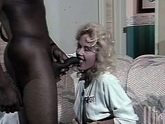 Take a look at this interracial sex scene in this vintage video where the slutty blonde Britt Morgan sucks and fucks a big black cock until her mouth's filled by semen.