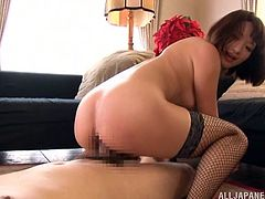 This sexy Japanese whore opens her legs so her man can play with that hairy pussy of hers. She's really wet and horny now, so she climbs on his cock and rides him nice and hard. She switches from cowgirl position to reverse cowgirl position.