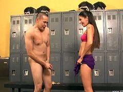 Bad girl Nikki Daniels gives a footjob to a guy in the locker room