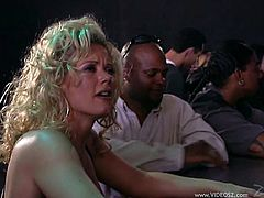 Get wild watching this blonde cougar, with big jugs wearing shorts, while she goes hardcore with a black fellow after a kinky show.
