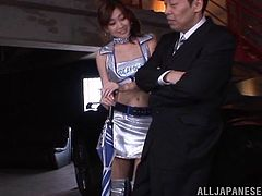 A pigtailed Japanese girl in a sexy uniform has threesome sex. This Asian babe strokes a dick while getting fucked in a missionary position.