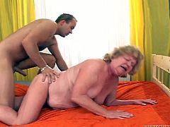 Hot tempered young dude drills puffy pussy of one cougar mature chick. He fucks her cunt doggy style and makes her big full natural tits bounce.