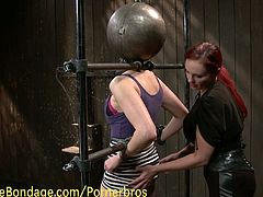 This smoking hot redhead mistress whips and spanks her slave before she pours hot wax on her and fists her pussy.