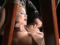 Beuatiful Mandy Bright is tied up to a ladder with no escape, and Salome comes to give her some spanking and nipple pinching.