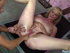 Dumpy blond haired hooker got her anus and pussy fisted hard