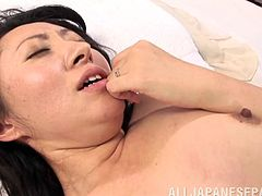 An Asian MILF kisses a younger guy and then takes off her clothes. Aya Kitagawa spreads legs and gets fucked in her hairy pussy.