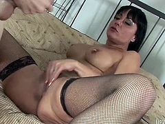 Seductive dark haired babe in lacy stockings gives her friend an amazing blowjob and in return she gets her wet pusy licked.