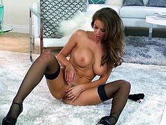 Captivating chick Emily Addison wearing lingerie and stockings is having fun in the living room. She fondles herself ardently and then fingers her shaved pussy.