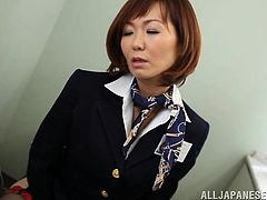 On a flight from Tokyo to Vancouver this dirty slut heads to the bathroom for some time to herself. She takes out her mini vibrator and presses it against her hairy pussy. She is dripping wet now, and she shoves the sex toy in deeper.