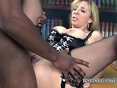 Sara Jay is a blonde milf with a pair of massive natural jugs. She gets her cunt stretched on her desk by a throbbing black cock. She also eats the cream from it.