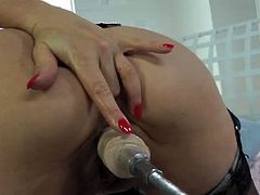 Check out this sexy redheaded slut name Vanessa in her black stockings. She loves to get her tight pussy stretched and this machine will make her cum like never before.