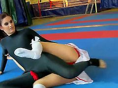 Celine Doll and Mira are staying in their sexual tight-fitting outfits and starting to have catfight in front of the camera. Watch these beauties wrestling and youll feel hot.