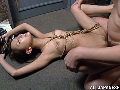 Take a nice look at this Asian brunette, with small boobs and a shaved twat, while she goes hardcore after pretending to be a slave.