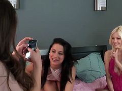 Three gorgeous nude models today Bree Daniels, Dani Daniels and Georgia Jones are together on this video. Watch these nymphos teasing and daring each other to kiss torridly.