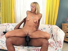 Old long haired whorish blondie got her still thirsting muff banged hard in reverse cowgirl style by feverish African dawg. Have a look at this dirty old whore in Fame Digital sex video!