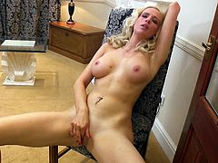 A blonde babe takes off a dress and sits down on a chair. Samantha shows off her juicy boobs and also fingers the pussy.