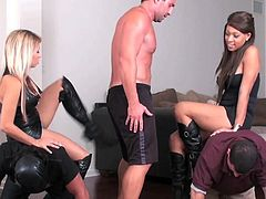 Babes in leather costumes look appealing while dominating horny studs in nasty group femdom porn show