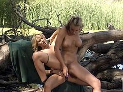 A couple of gorgeous lesbian babes with rockin' bodies having hot sex outdoors with some toys, check it out right here, yo!
