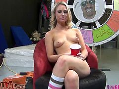 Sexy blonde wearing funny knee socks is ready to give best ever blowjob. Be sure that her hell working mouth hole can cope with all cocks around.