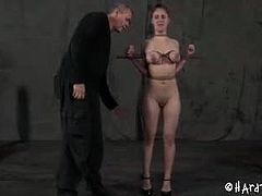 Iona Grace gets whipped and has her boobs wrapped and squeezed. Next, PD and his fellow mistress put three toys in Iona's pussy until she manages to squirt.