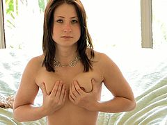 Make sure you see this! A brunette babe, with a nice ass and natural breasts, touches herself sensually lying on the floor. She's a kinky doll!