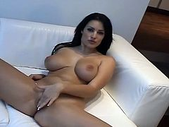 Check out this hot solo scene where the busty brunette Carmen Croft shows off her big natural tits before masturbating with a dildo.
