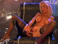 Captivating blonde milf Mandy Bright wearing a fishnet top is getting naughty indoors. She kneads her beautiful fake tits and then fingers her snatch and smashes it with a dildo.