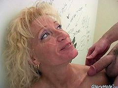 Entertain yourself by watching this cougar, with natural boobs and a smooth cunt, while she serves a tasty blowjob and another guy masturbates her.