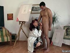 This aged redheaded painter needs to draw a hard cock, but as soon as she grabs this young guy's cock, she doesn't let go. She blows it and rides it wildly.