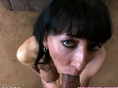 Pretty busty mom Alia Janine works on big dick with her hands and mouth