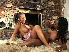 Lacey DuValle and Jada Fire lick each others pussies by the fireplace. These ebony girls also use a dildo and rub pussies in a scissors position.