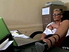 This slutty light haired bitch with awesome body and nice ass tickles her shaved pussy in the office. Have a look at thus babe in Thagson sex clip.