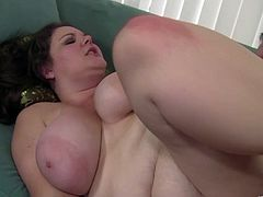 For a big girl this babe has some serious moves. She gets on top and rides as her tits swing and he spanks her nice, round ass.