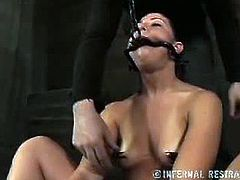 Mia Gold is Cyd Black's toy for a while. He puts a metal gag inside her mouth and fucks her cunt with a vibrator. Next, he uses tape to seal her mouth and whips her all over.