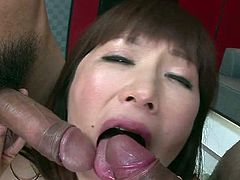 Experienced porn actress Reiko Shimura has got her big tits oiled up. She sucks two hard cocks in turn showing off her skills. She also gives awesome titjob.