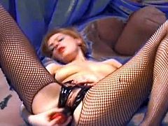 Milf in sexy fishnet pantyhose enjoys stiff toy cock while posing in close up the full solo show