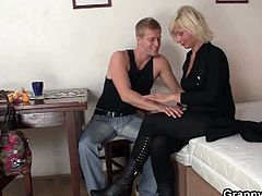 This blonde granny flirts with a young stud. He falls in her seductive trap and lets her feed on his cock before she sits on it and rides it cowgirl style.