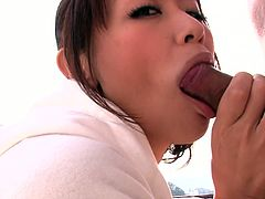 Adorable Japanese redhead babe Maika spends time outdoors with two small dicked guys. Cutie gives nice double blowjob sitting on her knees.