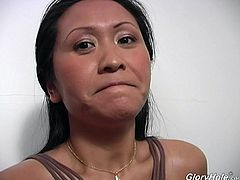 Mature Asian bitch Kitty Langdon sucks a BBC in gloryhole clip