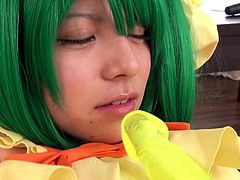 Are you a fan of kinky costumes? This Japanese babe definitely knows how to turn a guy on. Before getting down on her knees to suck a succulent dick, the young slut with green dyed hair plays dirty with a dildo. She goes crazy when a vibrator finds its way to her naughty pussy. Her hands are tied with shackles