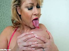 Samantha plays with her 38G boobs in the bathroom. She spits on one of them, after she sucks on her nipple. Next, she fingers her pink pussy nice and hard.